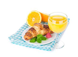 Orange juice and fresh croissant