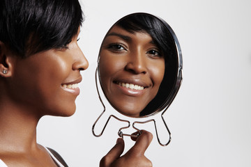happy black woman with mirror