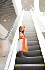 Little girl with shopping bag in mall