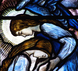 Two grieving angels in stained glass