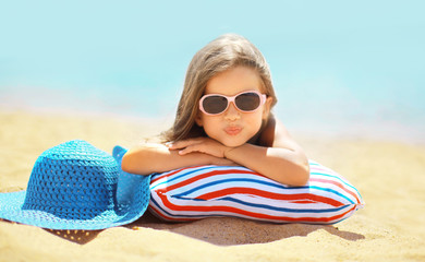 Summer vacation concept, joyful child in sunglasses
