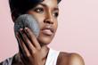 gorgeous black woman clean her skin