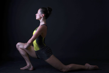 Beautiful woman doing sport exercises in studio