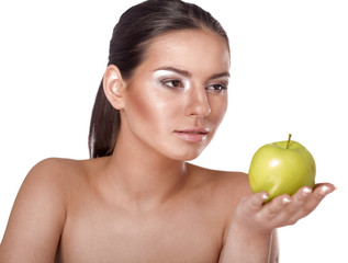 Young woman eating green apple isolated over white background
