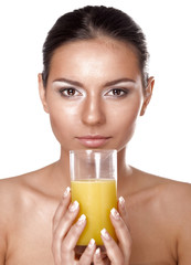 Young woman drinking orange juice , isolated on white background