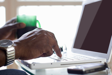 Portrait of an African American working on laptop