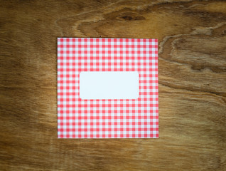 blank red an white checked windowed envelope