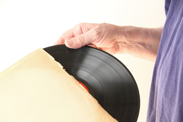 Removing vinyl record from sleeve