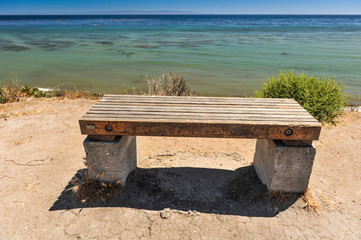 Wooden Bench on cliff by the ocean