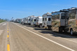 Row of recreational vehicles parked on road - 68041497
