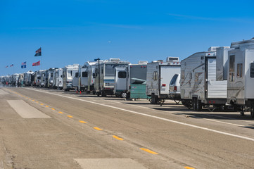 Row of recreational vehicles parked on road