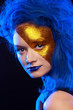 Portrait of young woman in superhero cosmetics