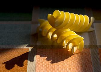 sun light drawing shadows with italian pasta