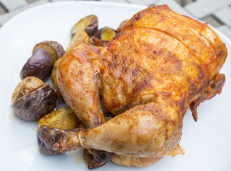 Rotisserie Chicken Served with Small Potatoes
