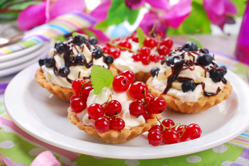 mini tartlets with whipped cream and fresh fruits