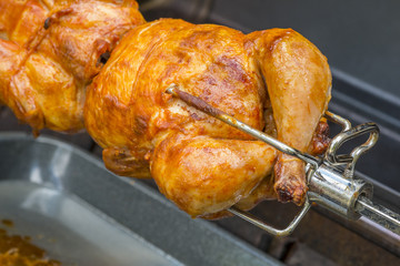 Rotisserie Chicken Over a Barbecue