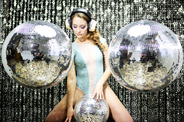 beautiful sexy disco dj woman in lingerie surrounded by discobal