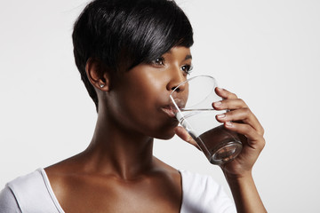 pretty african woman drinking water