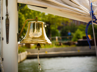 Yachting. Bell on sailing ship. Detail of a yacht boat