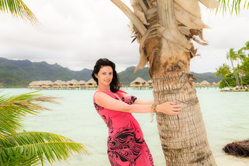 Young brunette on the beach in Polynesia