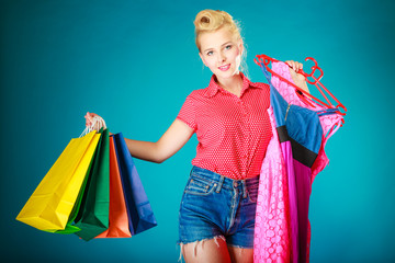 Pinup girl with shopping bags buying dress. Sale