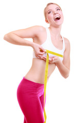 Fitness woman fit girl with measure tape measuring her bust