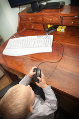 Little boy child kid playing on the computer
