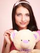 childish woman with teddy bear
