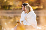 young couple having red wine outdoors - Fine Art prints