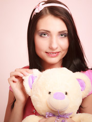 childish woman with teddy bear