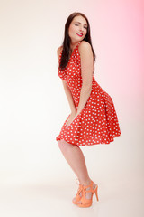 pinup woman in red dress in white dots