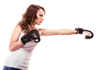 curly haired woman in boxing gloves