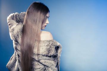 Long haired woman fashiot shoot. warm coat