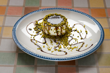 "Italian Dessert called ""panna Cotta"" with chocolate and pistachi"