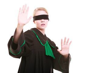 Lawyer attorney covering eyes with blindfold