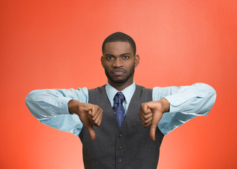 Displeased customer executive man giving thumbs down gesture
