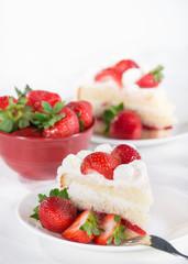 Slice of homemade strawberry cream cake with strawberries