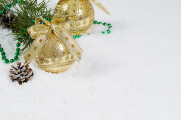 Golden Christmas Ornament on Snow