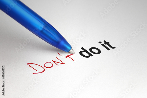 Don't do it. Written on white paper