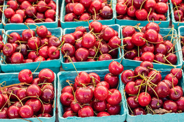Fresh sweet red cherries in boxes