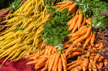 Fresh orange carrots on display at the market