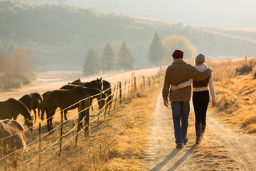 young couple walking in farm road