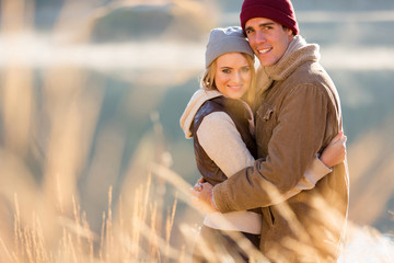 young couple hugging in autumn morning