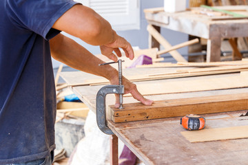 carpenter use saw cut wood formake new furniture