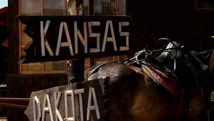 Sign to Kansas and dacota on horse background