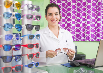 Optical store, professional woman and lenses.