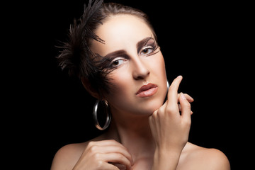 Woman with feathers and gothic make up