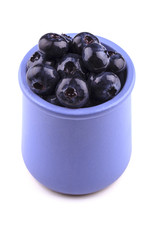 Blueberry in a cup isolated on white