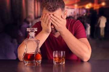 Addicted to alcohol man drinking alone at the bar