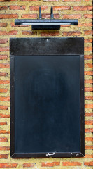 Black board on brick wall